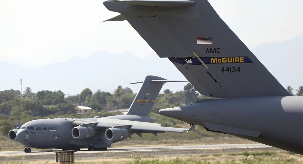 A second United States Air Force C-17 cargo plane loaded with humanitarian aid lands at Camilo Daza airport in Cucuta, Colombia, Saturday, Feb. 16, 2019.