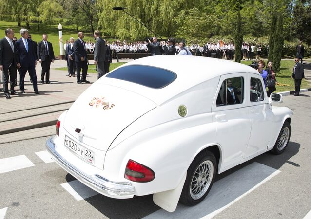 U.S. Secretary of State John Kerry admires Russian Foreign Minister Sergey Lavrov's Pobeda car