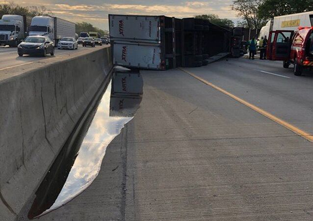 Semi-trailer hauling 41,000lbs of honey overturned and spilled amber honey and diesel down an Indiana highway, May 15, 2019