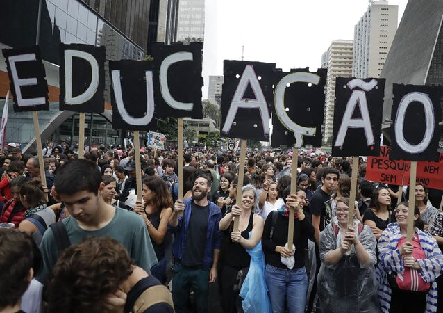 Demonstrators protest against a massive cut in the education budget imposed by the administration of Brazilian President Jair Bolsonaro, in Sao Paulo, Brazil, Wednesday, May 15, 2019. Federal education officials this month announced budget cuts of $1.85 billion for public education, part of a wider government effort to slash spending. (