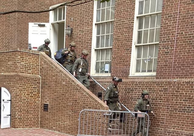 Police are seen walking out of a door at the Venezuelan embassy in Washington D.C., U.S. May 16, 2019 in this picture obtained from social media