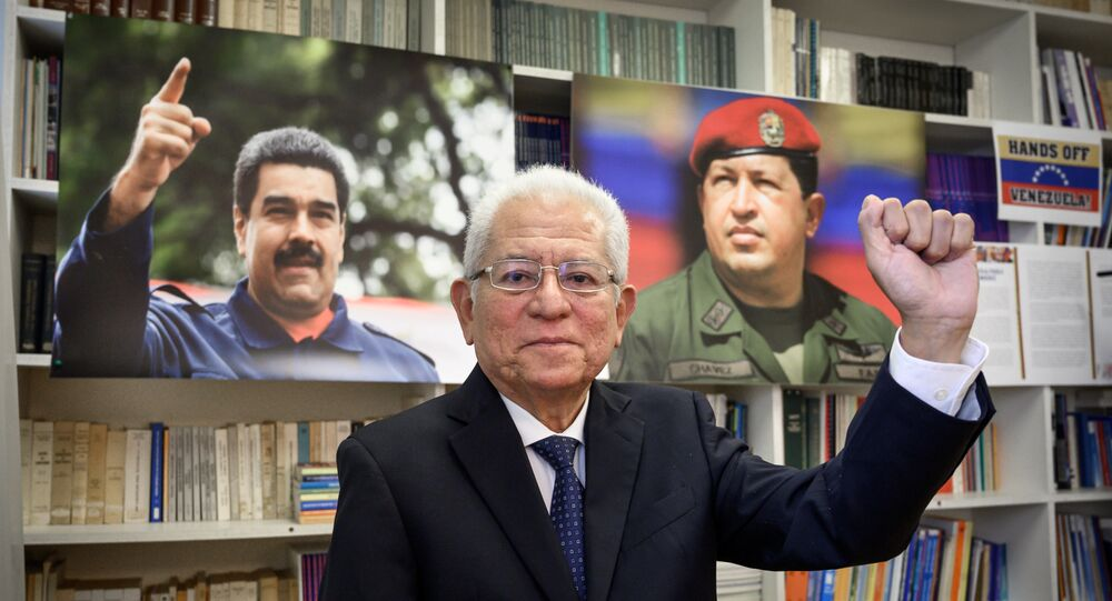 Venezuela Permanent representative to the United Nations in Geneva, Ambassador Jorge Valero poses between photographs of President Nicolas Maduro (L) and late President Hugo Chavez during a interview with AFP, at the permanent mission in Geneva on April 16, 2019