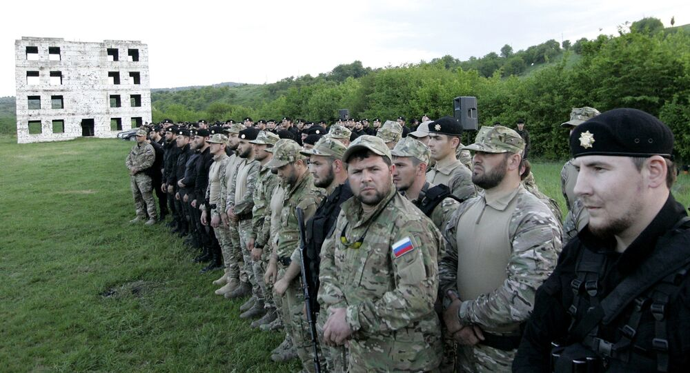 Participants in a shooting contest for the Terek special rapid response squadron of the Interior Forces, at a shooting range in the village of Tsentaroi, the Chechen Republic. The contest was held in memory of the first Chechen president, Akhmat Kadyrov, and to mark the coming Victory Day