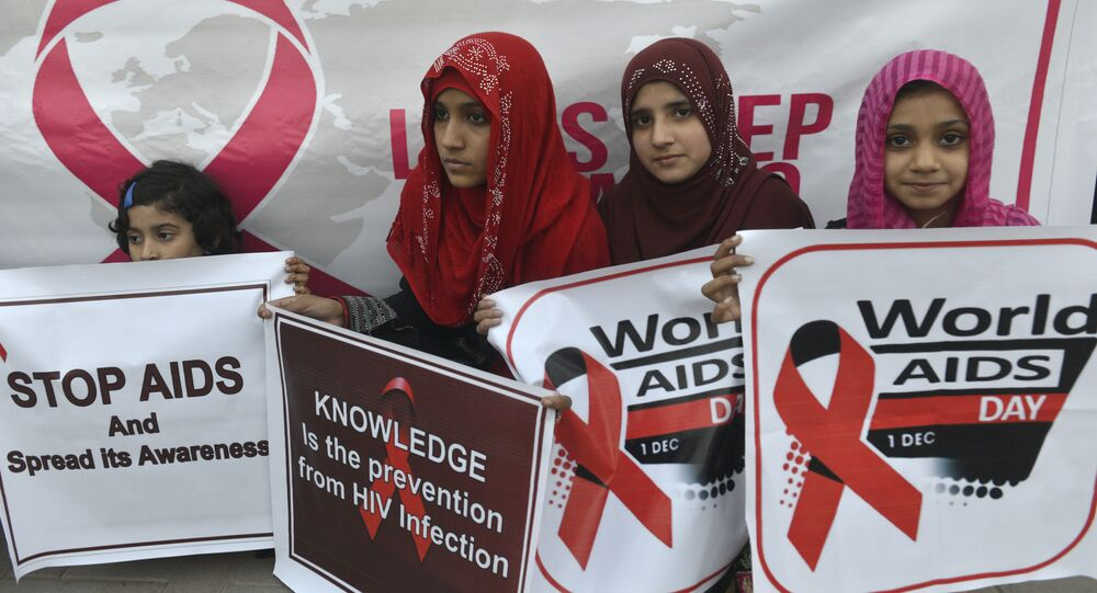 Pakistani social activists carry placards during a rally to raise awareness on World AIDS Day in Lahore on December 1, 2016