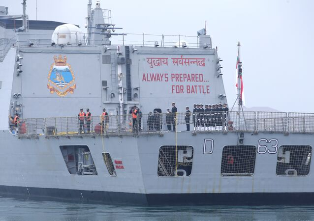 A slogan is seen on the back of the Indian navy commissioned warship INS Kolkata as it arrives at Qingdao Port for the 70th anniversary celebrations of the founding of the Chinese People's Liberation Army Navy (PLAN), in Qingdao, China April 21, 2019