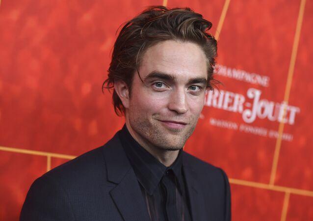 Robert Pattinson arrives at the 2018 amfAR Inspiration Gala Los Angeles on Thursday, Oct. 18, 2018 in Beverly Hills, Calif.