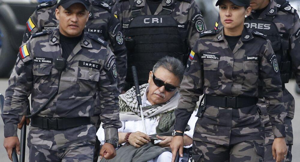 Prison guards escort former rebel leader Seuxis Hernandez outside La Picota jail in Bogota, Colombia, Friday, May 17, 2019