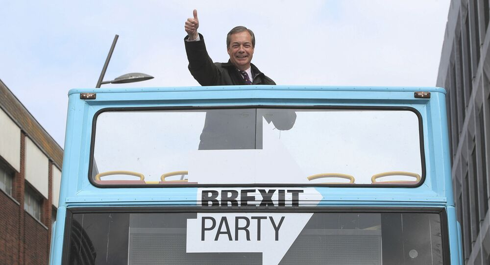 Brexit Party leader Nigel Farage gestures on an open topped bus while on the European Election campaign trail in Sunderland, England, Saturday, May 11, 2019