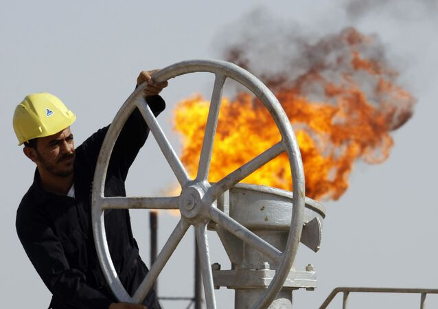 An Iraqi worker operates valves at the Nahran Omar oil refinery near the city of Basra, 340 miles southeast of Baghdad, Iraq