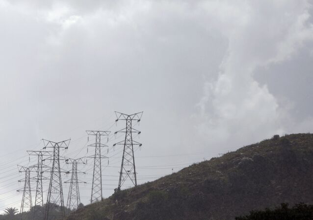 Eskom's electricity pylons snake across a hill in a Johannesburg suburb