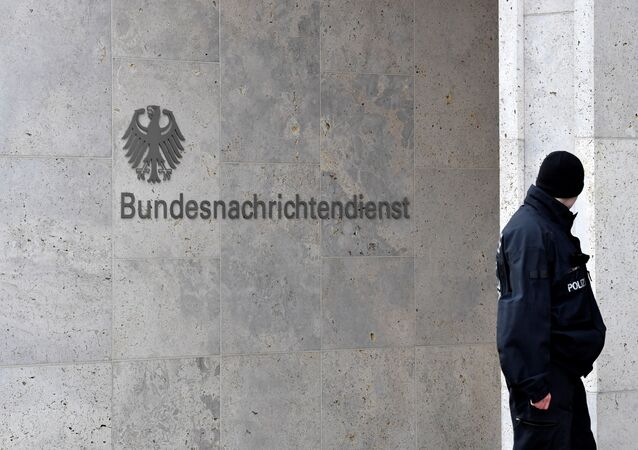 A policeman stands guard next to the logo and name of the German Federal Intelligence Service (BND)
