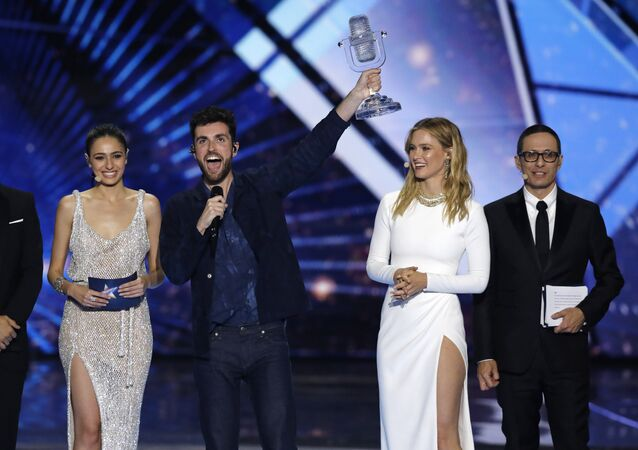 Duncan Laurence of the Netherlands, center, celebrates with the trophy after winning the 2019 Eurovision Song Contest grand final with the song Arcade in Tel Aviv, Israel, Saturday, May 18, 2019.