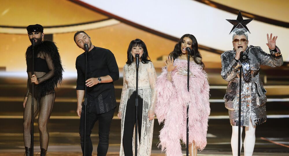 Former participants in the Eurovision Song Contest, Austria's Conchita Wurst, Swedish Mans Zelmerlow, Israeli singer Gali Atari, Greek singer Eleni Foureira and Ukrainian singer Verka Serdyuchka, from left, perform during the 2019 Eurovision Song Contest grand final in Tel Aviv, Israel, Saturday, May 18, 2019.