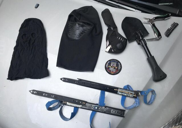 The mask and two self-made hidden blades taken away from the man who was arrested in Paris on Saturday 18 May