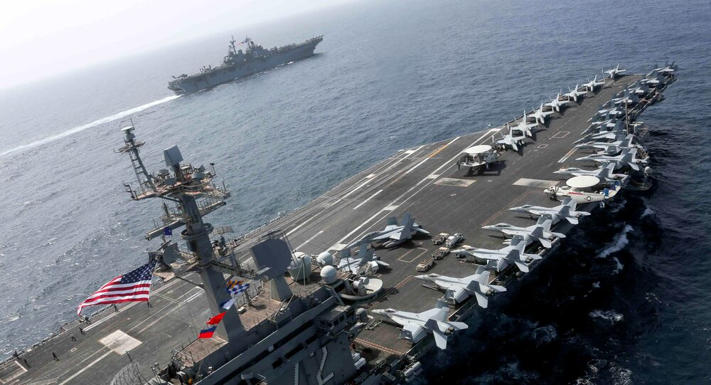 The Nimitz-class aircraft carrier USS Abraham Lincoln (CVN 72) and the Wasp-class Amphibious Assault Ship USS Kearsarge (LHD 3) sail alongside, as the Abraham Lincoln Carrier Strike Group (ABECSG) and Kearsarge Amphibious Ready Group (KSGARG) conduct joint operations, in the U.S. 5th Fleet area of operations in the Arabian Sea, May 17, 2019