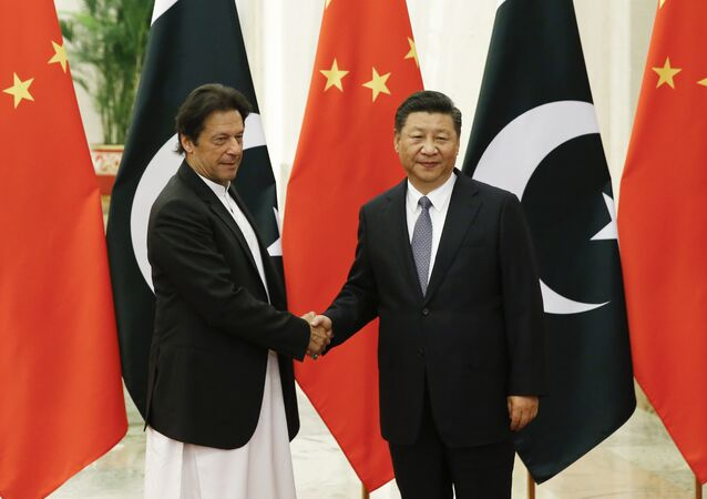 China's President Xi Jinping, right, meets Pakistan's Prime Minister Imran Khan at the Great Hall of the People in Beijing, Friday, Nov. 2, 2018