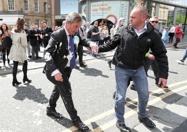 Brexit Party leader Nigel gestures after being hit with a milkshake while arriving for a Brexit Party campaign event in Newcastle, Britain, May 20, 2019