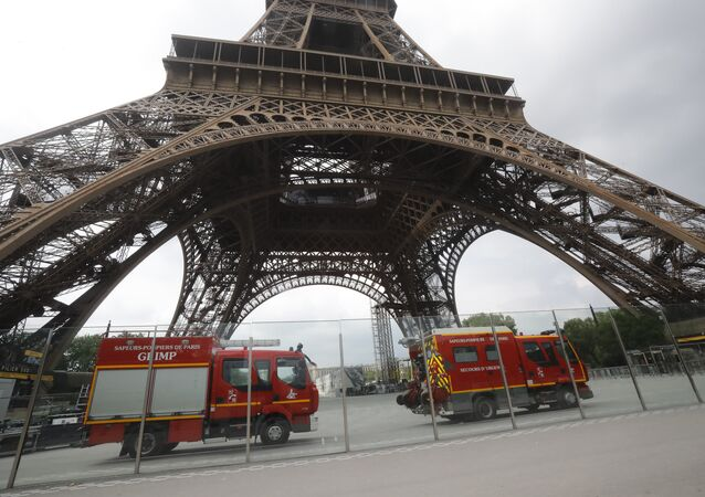 Rescue workers vehicles park just down the Eiffel Tower Monday, May 20, 2019 in Paris