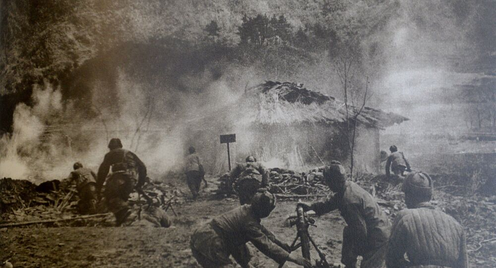 Chinese PLA soldiers firing mortars while penetrating the 38th parallel during New Year's Day offensive.