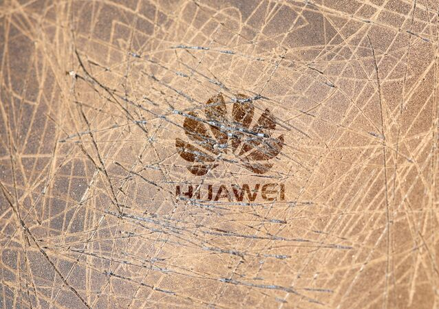 A scratched surface Huawei logo is seen on a smarthphone in this illustration picture taken May 20, 2019