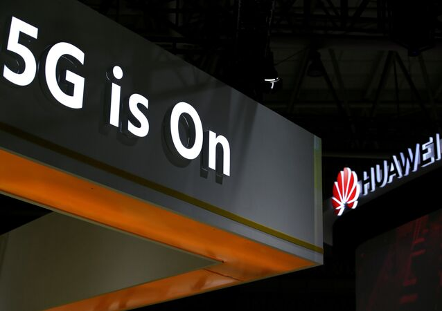 A Huawei logo is seen at an exhibition during the World Intelligence Congress in Tianjin, China May 16, 2019