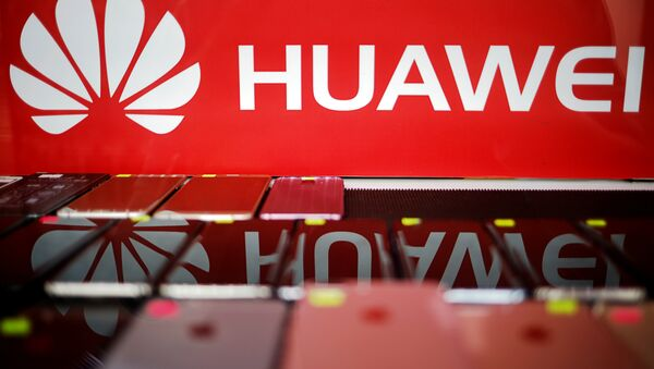 The logo of Huawei is pictured at a mobile phone shop in Singapore, May 21, 2019 - Sputnik International