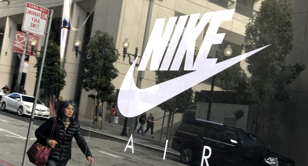 The Nike logo is displayed on a window at a Nike store on March 21, 2019 in San Francisco, California.