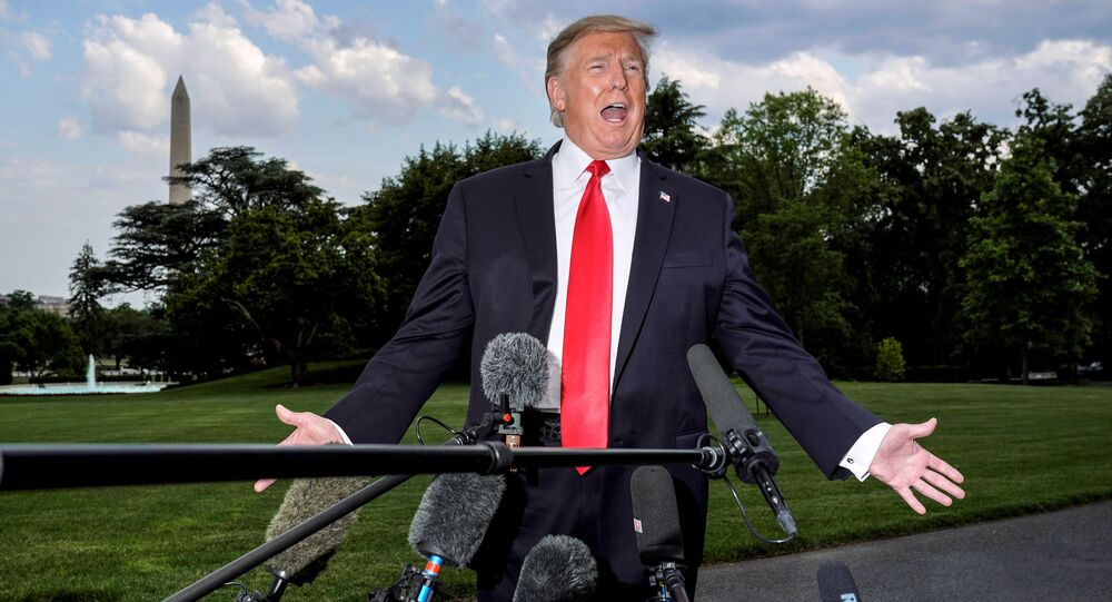 U.S. President Donald Trump speaks to the media as he departs for a campaign rally from the White House in Washington, U.S., May 20, 2019