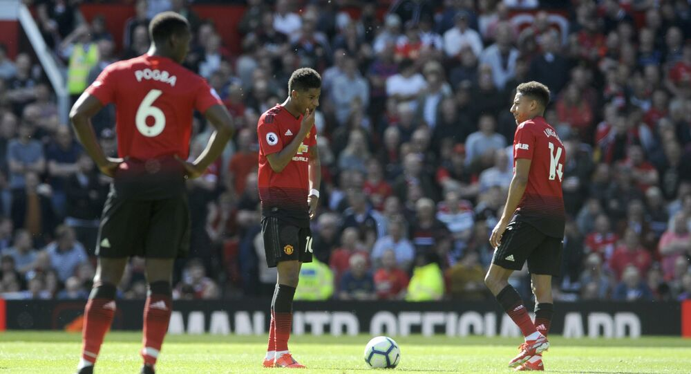 Manchester United's Paul Pogba, Marcus Rashford and Jesse Lingard react to defeat to Cardiff in the last game of the season
