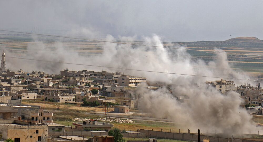 This picture taken on May 22, 2019 shows smoke plumes rising from the Syrian town of Khan Sheikhun in the southern countryside of the rebel-held Idlib province.