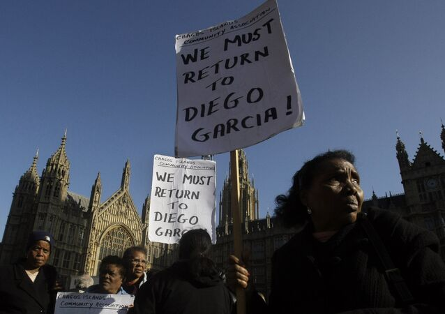 A protest outside the Houses of Parliament in London, after a court ruling decided Chagos Islanders are not allowed to return to their homeland