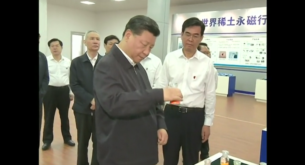 Chinese President Xi Jinping inspects rare earth metals at a mining and refinement facility in Jiangxi Province
