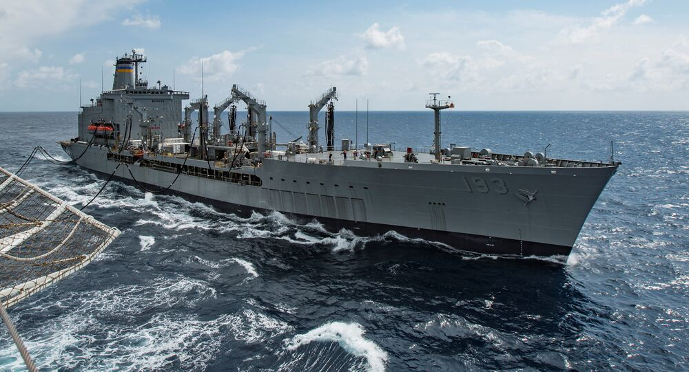 Military Sealift Command fleet replenishment oiler USNS Walter S. Diehl (T-AO 193) pulls alongside hospital ship USNS Mercy (T-AH 19) to deliver supplies and mail by a connected replenishment in the South China Sea August 15, 2016