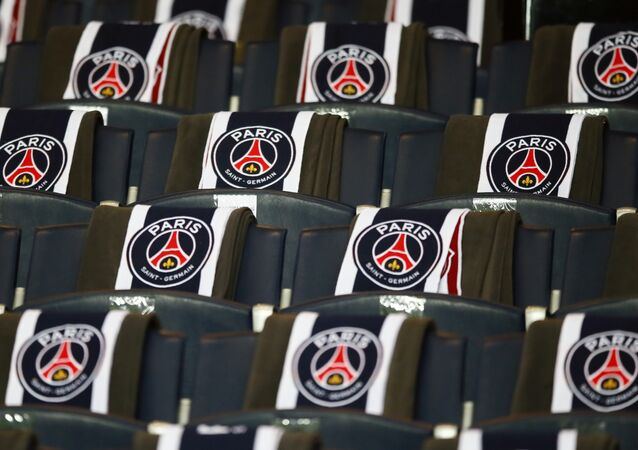 The logos of the Paris Saint Germain are displayed on the seats of the vip stands prior to the Champion's League round of 16, first leg soccer match between Paris Saint Germain and Barcelona at the Parc des Princes stadium in Paris, Tuesday, Feb. 14, 2017