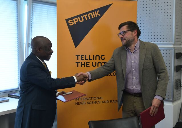 Sergei Kochetkov, Rossiya Segodnya First Deputy Editor-in-Chief, and Ernest Kabila Ilunga, Director General of RTNC.