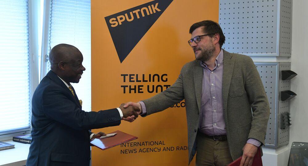 Sergei Kochetkov, Rossiya Segodnya First Deputy Editor-in-Chief, and Ernest Kabila Ilunga, Director General of RTNC.