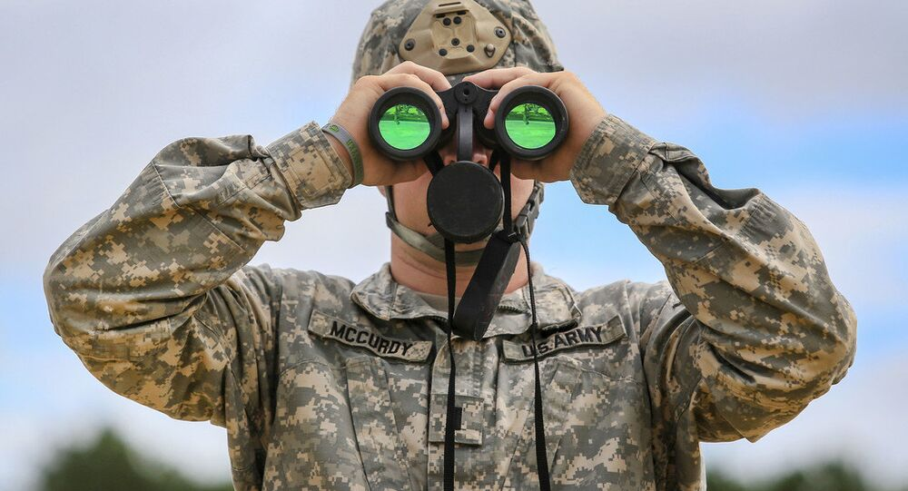 Army 1st Lt. James McCurdy uses binoculars to observe targets down range while his soldiers fire MK 19 grenade launchers during training at Joint Base McGuire-Dix-Lakehurst, N.J., July 26, 2018
