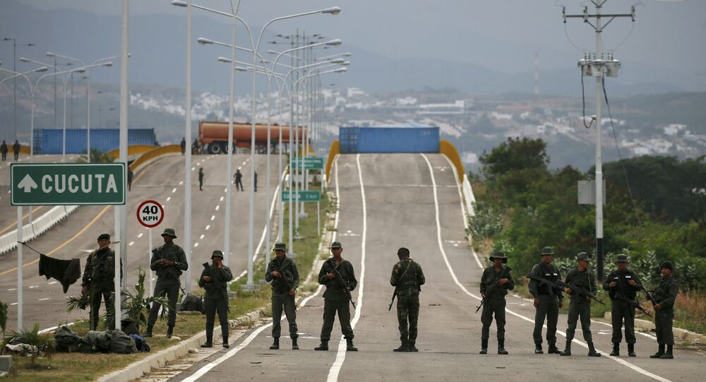 Venezuelan Bolivarian Army soldiers stand guard at the Tienditas International Bridge that links Colombia and Venezuela, near Urena, Venezuela, Friday, Feb. 8, 2019.