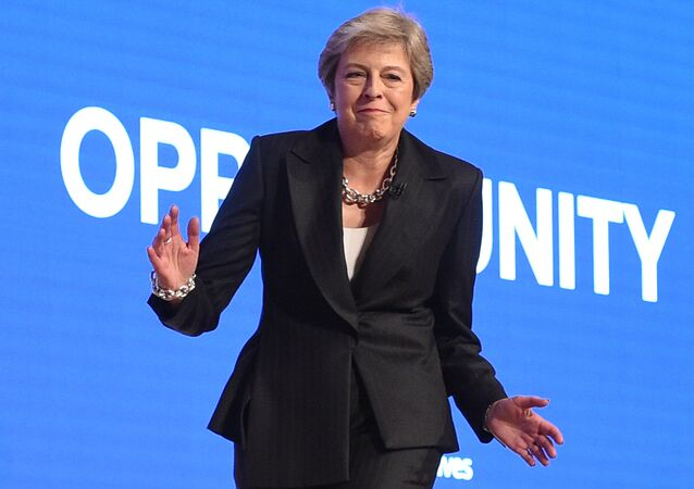Britain's Prime Minister Theresa May dances a few steps as she takes the stage to give her keynote address on the fourth and final day of the Conservative Party Conference 2018 at the International Convention Centre in Birmingham, central England, on October 3, 2018