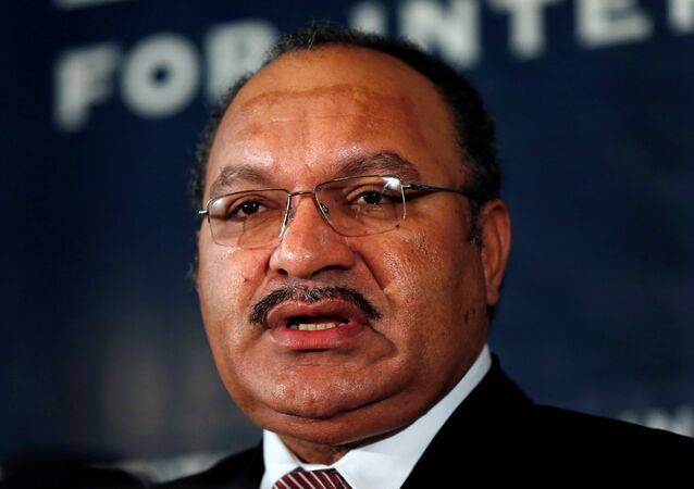 FILE PHOTO: Papua New Guinea's then Prime Minister Peter O'Neill makes an address to the Lowy Institute in Sydney, Australia