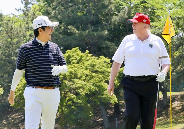 U.S. President Donald Trump talks with Japanese Prime Minister Shinzo Abe as they play golf at Mobara Country Club in Mobara, Chiba prefecture, Japan, in this photo released by Japan's Cabinet Public Relations Office via Kyodo May 26, 2019