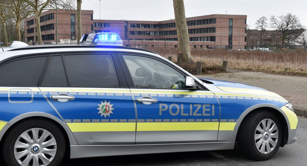 A picture taken on March 12, 2019 in Gelsenkirchen shows a German police car blocking the access to the tax office after its evacuation due to an email containing a bomb threat.