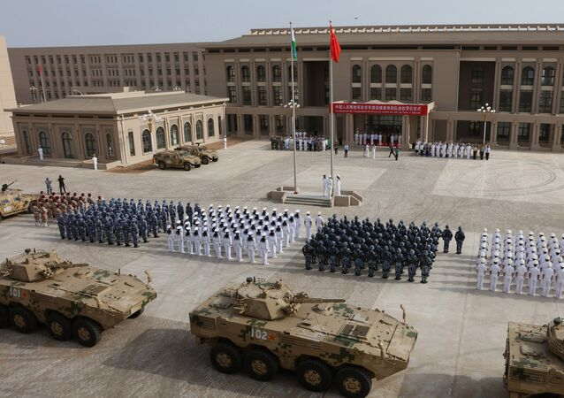 This photo taken on August 1, 2017 shows Chinese People's Liberation Army personnel attending the opening ceremony of China's new military base in Djibouti