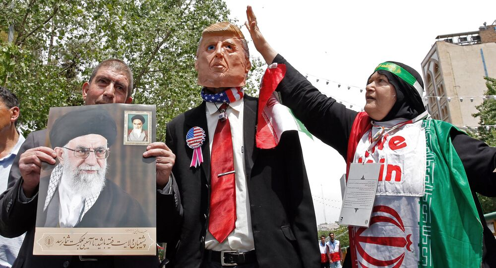 Iranian demonstrators carry a portrait of Iran's Supreme Leader Ayatollah Ali Khamenei and an effigy of US President Donald Trump during a rally in the capital Tehran, on May 10 2019
