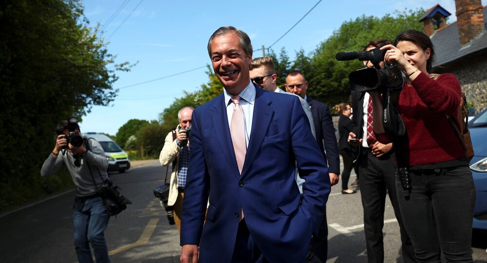 Brexit Party leader Nigel Farage leaves a polling station after voting in the European elections, in Biggin Hill, Britain, May 23, 2019