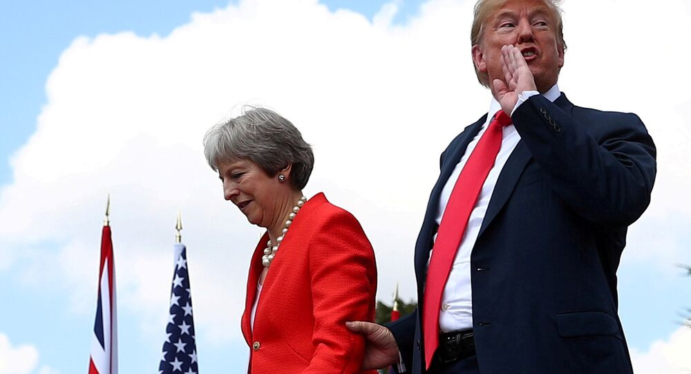 Britain's Prime Minister Theresa May and U.S. President Donald Trump walk after holding a joint news conference at Chequers, the official country residence of the Prime Minister, near Aylesbury, Britain, July 13, 2018