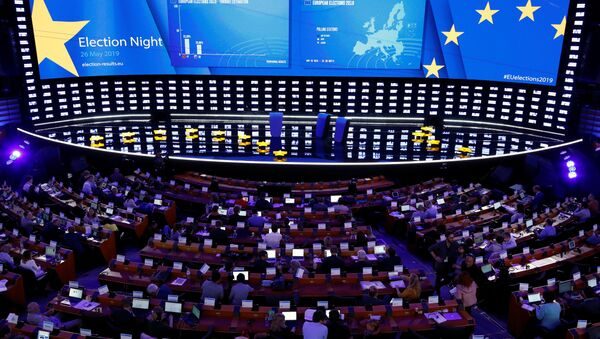 Exit poll results are displayed on a screen at the Plenary Hall during the election night for European elections at the European Parliament in Brussels, Belgium, May 26, 2019 - Sputnik International