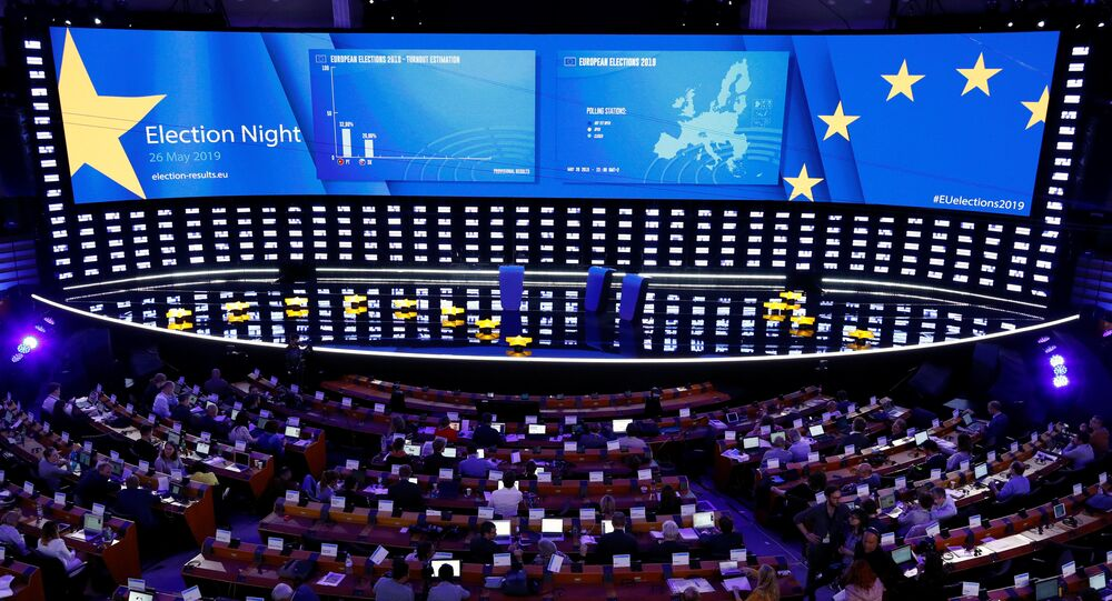 Exit poll results are displayed on a screen at the Plenary Hall during the election night for European elections at the European Parliament in Brussels, Belgium, May 26, 2019