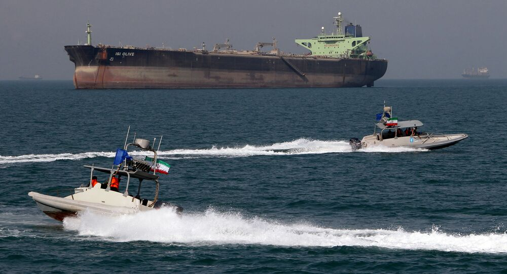 Iranian Revolutionary Guard speedboats cruise past an oil tanker off the port of Bandar Abbas, southern Iran, on July 2, 2012