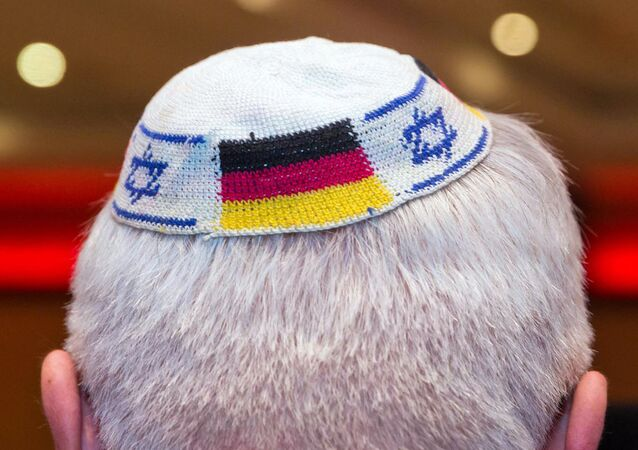 (FILES) Picture taken on June 10, 2014 in Frankfurt am Main, western Germany, shows a man wearing a Jewish kippa skullcap with the flags of Germany and Israel